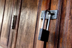 Locked wooden door with key chain Royalty Free Stock Images
