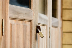 Locked wooden door with key chain Royalty Free Stock Photos