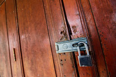 Locked wooden door with key chain Stock Photography