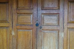 Locked wooden door. Old wooden door is locked Stock Image