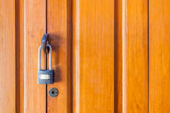 Locked wooden door, private zone as Home. Royalty Free Stock Photography