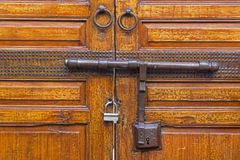 Locked wooden door Royalty Free Stock Images