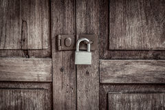 Locked wooden door with silver padlock Royalty Free Stock Image