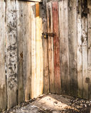 Locked Wooden Door in Sunlight Royalty Free Stock Image