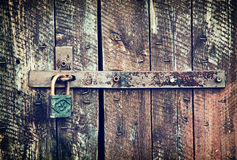 Locked wooden doors close up Stock Photos