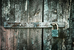 Locked wooden doors close up, retro style Stock Images