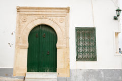 Locked Wooden Front Door of the Old House in Mahdia Royalty Free Stock Images