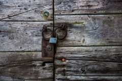Locked wooden gate Stock Images