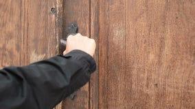 Locked Wooden Old Door. Someone try to open the door but the door latch is locked stock video