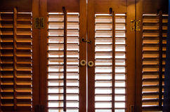 Locked wooden window shutters from the inside. Locked wooden window shutters closed from the inside Royalty Free Stock Photos