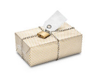 Locked wrapped package in gold striped paper. Stock Photos