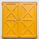 Locked yellow gate with padlock, background Royalty Free Stock Image