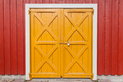 Free Locked Yellow Wooden Gate In Red Wall, Background Stock Photos - 57071783