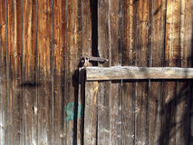 Locked2. Old wooden door with strong modern padlock Royalty Free Stock Photos