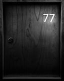 Locker with number seventy seven. 77 Royalty Free Stock Image
