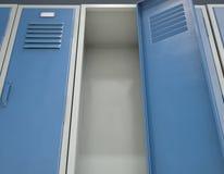 Locker Open. A row of blue metal school lockers with one open door revealing that it is empty - 3D render Royalty Free Stock Photos