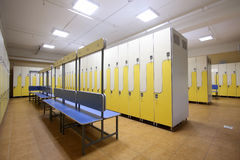 Locker room. Modern locker room with numbers of metal cases for clothes royalty free stock photography