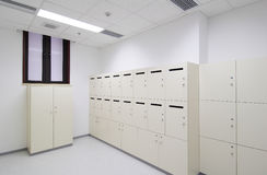 Locker room. Dressing room whit white lockers in the company Stock Photos