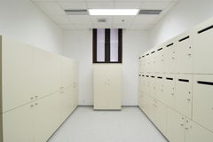 Locker room. Dressing room whit white lockers in the company Royalty Free Stock Photos