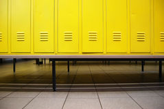 Locker room. Yellow doors in a locker room and a bench royalty free stock image
