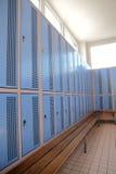 Locker room. Classic locker room with light blue rows of lockers Stock Photo