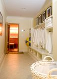Locker room with bathrobes towels Stock Image