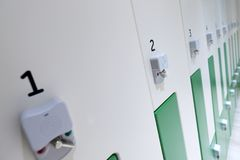 Locker room with security compartments. In a row Royalty Free Stock Images
