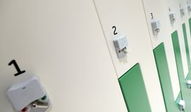 Locker room with security compartments. In a row Royalty Free Stock Image