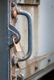 Locker securing old heavy iron door Royalty Free Stock Photo