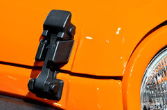 Locker of sport roadster engine hood. Locker of engine hood of a cross-country sports car in orange, which color and shape is beautiful, shown as industrial and Royalty Free Stock Photography
