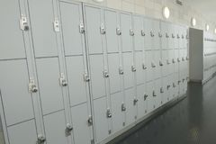 Lockers. Gray school lockers in a hallway with locks stock photo