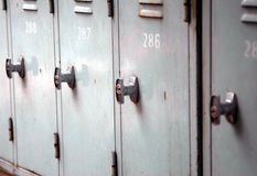 Lockers in a locker room. A row of numbered lockers in a locker room Stock Photography