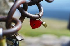 Lockers of lovers in the shape of heart buttoned on chains royalty free stock photos