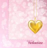 Locket dell'oro sul colore rosa Fotografia Stock
