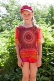 lockflicka little som är röd Fotografering för Bildbyråer