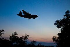 Lockheed C-130 Hercules. Silhouette of Lockheed C-130 Hercules at Dusk Royalty Free Stock Images