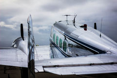 Lockheed Electra Passenger Plane. Vintage Lockheed Electra passenger plane sitting on the runway Stock Images
