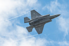 Lockheed Martin F-35B. Farnborough, UK - July 5, 2016: Low level aerobatics by a Lockheed Martin F-35B Lightning II in the skies over Farnborough, Hampshire, UK Stock Images