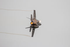 Lockheed Martin F-35 Lightning II. F-35 Lightning II firing off flares during a flyby on it's European debut at the Royal Netherlands Air Force Days stock photography