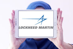 Lockheed martin logo. Logo of lockheed martin weapons manufacturing company on samsung tablet holded by arab muslim woman Royalty Free Stock Images