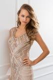 Lockig flicka i härlig klänning royaltyfria foton