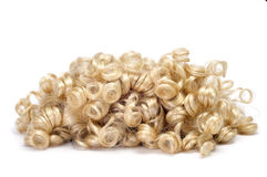 Lockige blonde Perücke Lizenzfreie Stockbilder