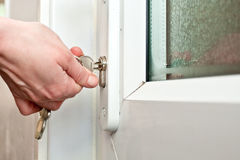Locking. A hand locking a door Stock Image
