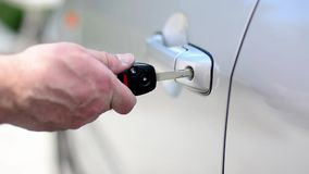 Locking a car door with a key stock footage