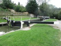 Water-way channel system for small boats in Bath England. Locking channel mechanism for a small town river in Bath England Stock Photos