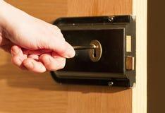 Locking the door stock images