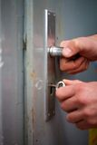 Locking a grey door Stock Images