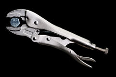 Locking Pliers Locked On To A Bolt Royalty Free Stock Photos