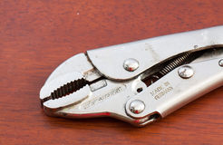 Locking pliers on wood background Royalty Free Stock Image