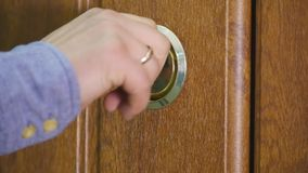 Locking up or unlocking door with key in hand.  stock video footage